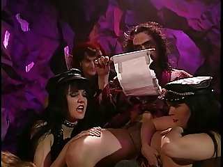 Blonde whore gets fucked in all holes by dudes in devil costumes