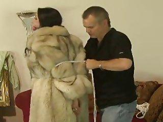 Bondage in fur coat