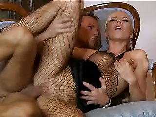 blond in fishnet catsuit