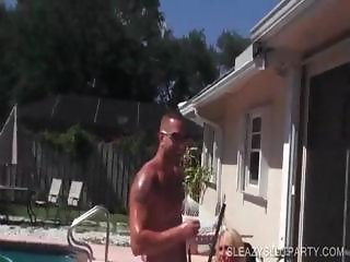 Topless bitches tanning by the pool