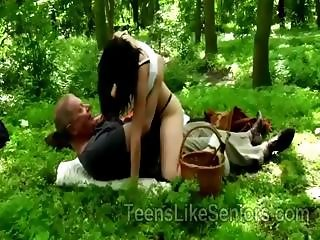 Hot young nymph goes naughty on grandpa during picnic in the woods
