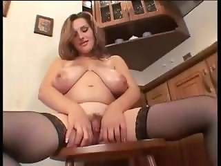 Horny pregnant chick with huge droopy tits masturbates in the kitchen