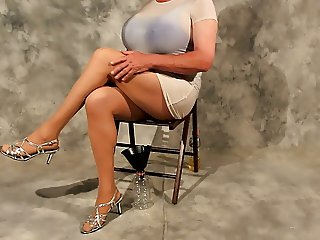 Crossdresser in White over her blue swimsuit