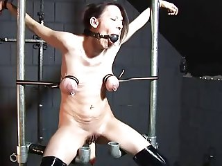 Tit restraint and fuck machine