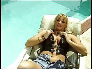 Sexy blonde babe by pool titty fucking a nice hard dick