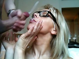 blonde with glasses having a facial