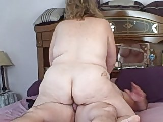 wife riding me on the bed as i come