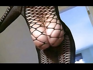 A buxom bombshell in a fishnet dress