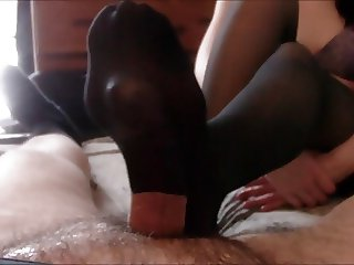 HOT black pantyhose footjob