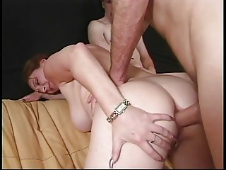 Two guys double penetrate a lonely brunette widow