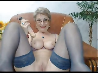 Mature lady with glasses and dildo
