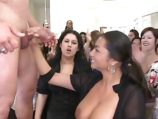 Busty mature does handjob in public