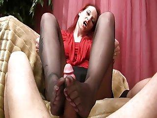 sensual footjob on sofa in black nylons