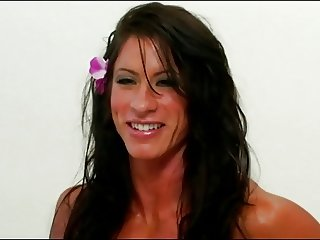 Muscle woman plays with big clit