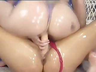 German Girls Wrestling in Oil with a Dildo 3
