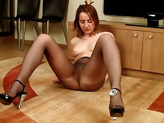 She Takes Off Her Jeans And Shows Her Black Pantyhose