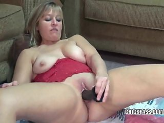 Curvy housewife Liisa fucks a big black dildo