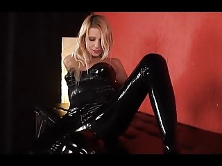 Beautiful blonde latex mistress and her latex slave