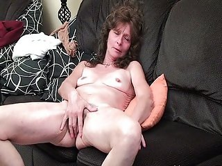 Sleazy grandma with saggy tits finger fucks