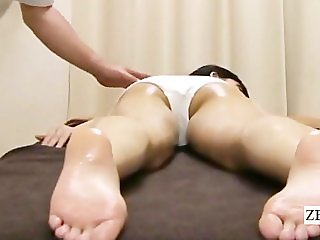 Subtitled shy topless Japanese schoolgirl oil massage