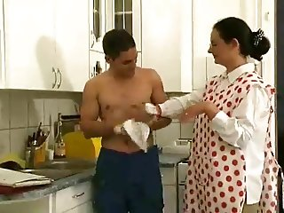 Hairy wet mature fucking with her toy boy in the kitchen