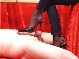 hot footjob with high heels and black stockings