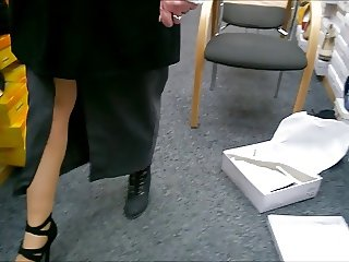Upskirt in shoestore, stockings and panties