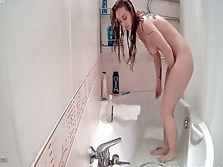 Beautiful blonde takes a bath