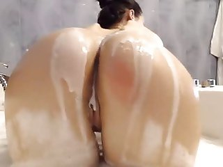 Hot bath tease with sexy brunette
