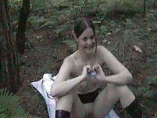 cute teen spreads her legs in the forest