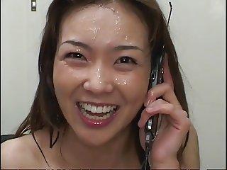 Bukkake while she talks on the phone