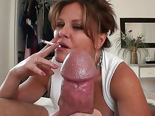 Hot Mature Smoking Cougar Jerks It Out