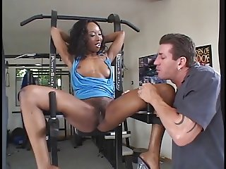 Ebony chick banged in the gym