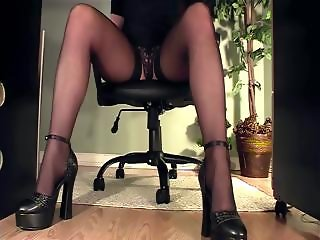 Leggy nympho secretary gets caught on cam masturbating under the desk