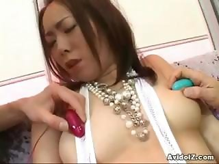 Horny Asian slut enjoys toy insertion