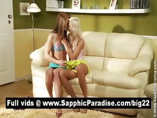 Hot redhead and blonde lesbians kissing and licking nipples and having lesbian love