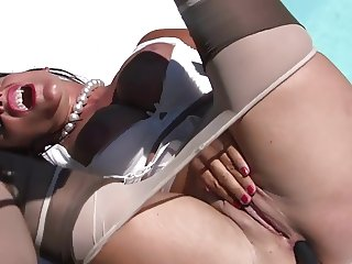 Fingering herself beside a pool