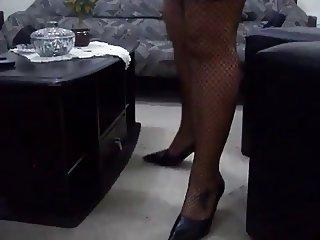 Latina Fishnet Legs Crossed