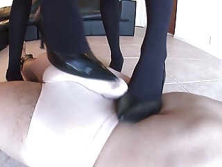 Two Hot Japanese Girls Dominate Guy With Their Heels