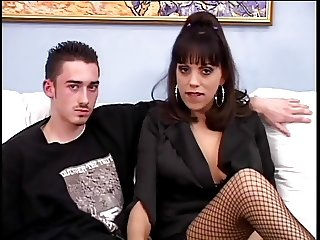 Tattooed MILF in fishnet stockings loves having young cock fuck her hard