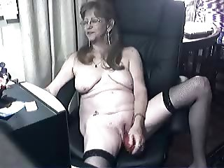 Pervert cute granny having fun at computer. Amateur
