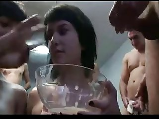 spanish bukkake - 2 girls share a sperm cocktail