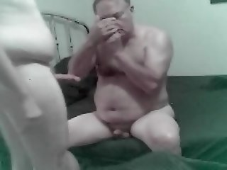 Mature grandpa dad bear plays with younger grandson