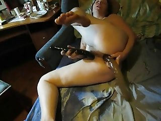 Lili masturbating with two dildos and cums.