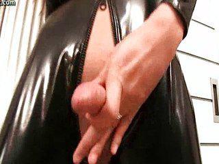 Shemale in latex uniform fingering