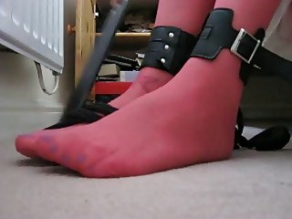 Crossdresser bound ankles feet in pink tights cum