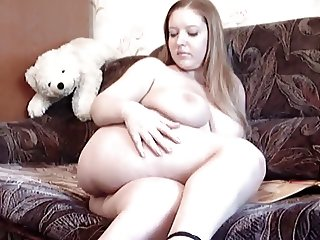 Sensual fatty girl plays with her pussy