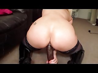 British slut Lucy G plays with a huge dildo