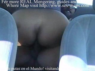 Prostitutes makea a tourist happy in his car