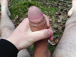 Teen boy jerking his cock in the forest